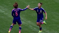 Yuki Ogimi of Japan celebrates with Mizuho Sakaguchi of Japan after scoring