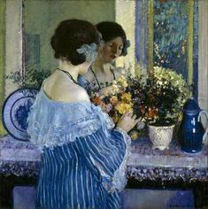 Frederick Carl Frieseke - Girl in Blue Arranging Flowers