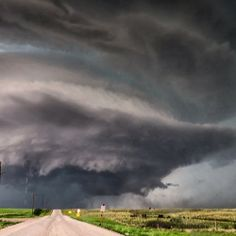 Massive supercell thunderstorm looming over the prairie near Lipscomb, Texas, June 22, 2014.