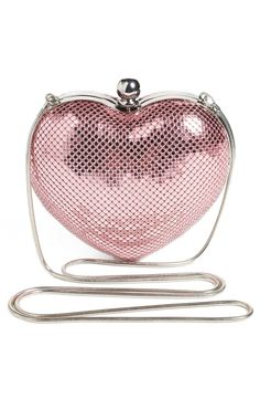 How cute is this metallic pink compact in a heart shape?