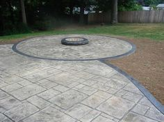 Stamped Concrete Patio And Theres A Hole Amid The Terrace With Trees Stamped Concrete Patio Designs That Enhance The Quality Of Your Environment Patio alternatives foundation base thickness designs with fire pit drainage pictures and retaining wall Concrete Patios, Concrete Patio Designs, Concrete Fire Pits, Backyard Patio Designs, Fire Pit Backyard, Backyard Landscaping, Patio Ideas, Pergola Patio, Backyard Ideas