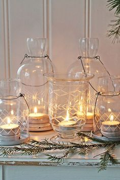 Christmas candle vignette in clear etched jars ( vibeke design ) White Christmas, Christmas Time, Xmas, Lantern Lamp, Candle Lanterns, Diy Luminaire, Vibeke Design, Fresh Farmhouse, Candle In The Wind