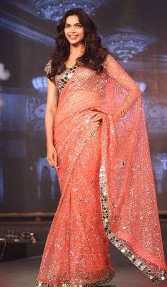 Deepika Padukone in orange mirror work saree by Manish Malhotra