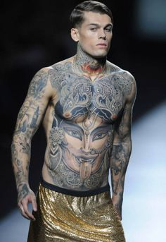 tattoed runway model