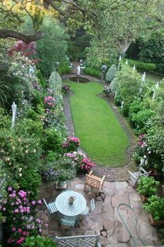Back yard space with nice combination of open space & plantings, with both grass and stone patio plus room for a garden