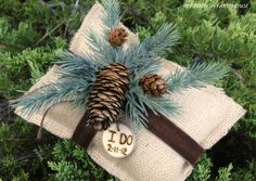 Ring Bearer Pillow Rustic Winter Wedding Decor Burlap with Personalized Wood Heart Custom (Your Color Choice of Ribbon and Flower). $29.00, via Etsy.
