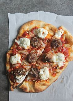 Creamy dollops of ricotta, spicy Italian sausage, on naan bread. You need this pizza in your life!
