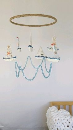 This handmade sail boat baby mobile is perfect for your nautical nursery or ocean beach theme nursery. 6 darling sail boats hang on a free spinning hoop to Nautical Theme Nursery, Ocean Themed Nursery, Baby Girl Nursery Themes, Baby Boy Room Decor, Baby Room Design, Baby Boy Rooms, Nursery Neutral, Light Blue Nursery, Nautical Mobile