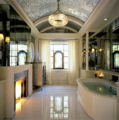 bathrooms with fireplaces | Ideas Also Luxury Master Bathroom With White Bathtub And Fireplace ...