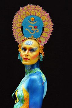 A participant poses with her body paintings designed by bodypainting artist Yasmina Jacinto during the World Body Painting Fest.