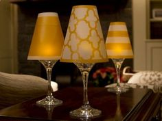 Fantastic and CHEAP idea as a do-it-yourself craft project !!!! I can imagine about a dozen or two down the center of the buffet table with some of them on different height risers. Of course, I highly suggest flameless votives. SO EASY TO DO !!!! Wine Glass Lamp Shades from di Potter