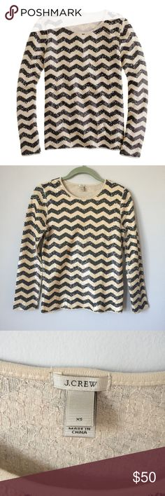 J. Crew Zig Zag Sequin Striped Top J. Crew sequins stripe shirt in chevron pattern. Really cute, perfect to wear on a night out. Also looks cute layered over a button down! Gently worn, the sequins are a bit loose under the arms but in overall great condition. I'll take reasonable offers! J. Crew Tops