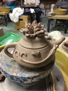 Teapot in wet stage.   I'm having second thoughts about the flower on the lid. I may end up removing it.
