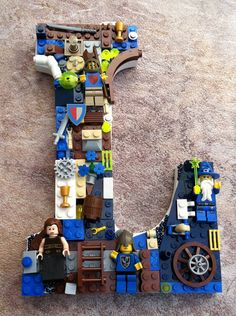 personalized lego wall letter for kid's room - just hot glue legos to a wooden letter.