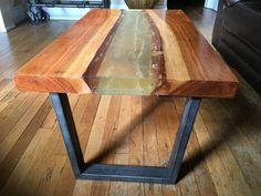 This custom-made live edge river table is a truly stunning piece of art. Made with care from solid maple, it features a clear resin-epoxy center which light easily passes through and illuminates the floor underneath. The raw steel legs are built from 1 x 2 steel tube welded to heavy duty mounting plates, and the form is true to classic mid-century designs. Most river tables feature a middle section made of glass, which can easily chip and/or break over time. Not the case with this one, as…