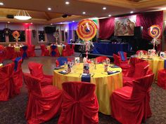 Bright and colorful circus room decor, red, yellow and blue decor, chair covers Circus Room, Train Table, Chair Covers, Calgary, Yellow, Blue, Floral Design, Room Decor, Bright