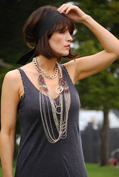 dont like the hair do but love the tank top with pearls look. Love mixing casual and classy pieces.