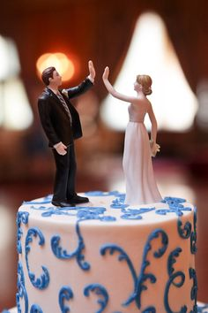 What a fun cake topper! (For all the HIMYM fans out there!)  -  our high five wedding cake topper is available here....http://www.weddingfavorsunlimited.com/high_five_bride_and_groom_figurines.html