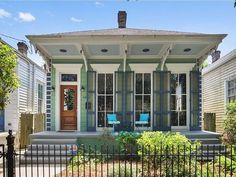 The shotgun home is as synonymous to New Orleans as Mardi Gras is to the city. New Orleans Decor, New Orleans Homes, New England Homes, Exterior House Colors, Exterior Paint, Shotgun House Interior, Fixer Upper House, Storybook Homes, House Fan