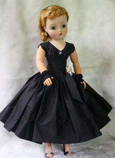 This Cissy is in superb condition. Her hair is in original set, her body is in excellent condition, and her outfit is pristine. Her head,