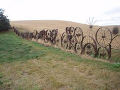 upcycled fence--possible weaving between the spokes in the nature art area