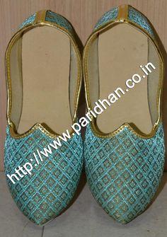 Exclusive designer mojari made in turquoise blue color brocade fabric.
