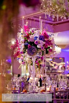 LOVING this purple and lavender floral and crystal chandelier centerpiece