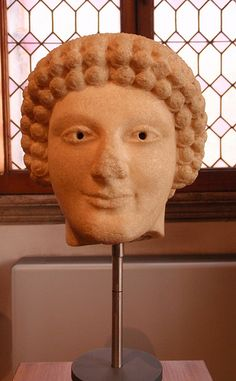 A young man of Greater Greece Head of a Kouros 6th cent-5th BCE insular marble Magna Graecia purchased in Rome Museo  Baracco,Rome,Italy