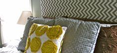 A simple grey chevron headboard looks great with bright pillows. #DIY #headboard