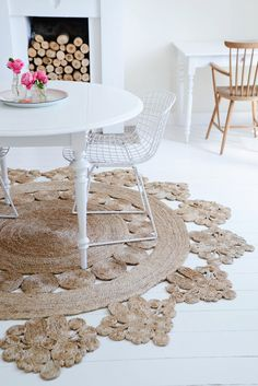 so what if you crocheted this rug? Large circle. then small circles. then decor pieces on to wide band?