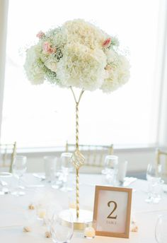 Classic cream florals, tall gold stand, bright and simple centerpieces  // Stephanie Rawcliffe Photography