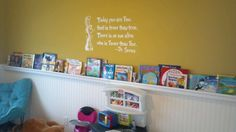 Beadboard WALLPAPER that looks like the real thing! I paired this with gutter shelves and a fun Dr Seuss vinyl wall quote for our playroom