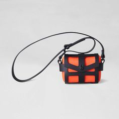 NEON ORANGE TINY CAGE BAG