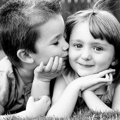 First peck on the cheek, Smiling little children.