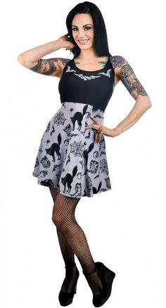 This Vintage Graveyard Ginger Dress is frightfully fierce. This cute skater dress is eerily awesome. The dress has a black bodice with grey bats decorating around the round neckline. The grey skirt flares loosely from the waist and is decorated with a repeat pattern of black cats, spider webs, skulls and all thing creepy cute. It's made from stretchy fabric and has adjustable thin straps for extra comfort.