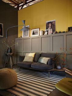 "Cherished Gold: ""Call it mustard yellow, call it saffron, the truth is that Cherished Gold has been featured in many homes for some time now as it goes well with two more colours that have been trending in the recent years: blue and grey. Shown here within a barn conversion, combined with mouse grey panels to create layers and 3D texture, this colour is calming without being boring. Less humorous and definitely not as offensive as the lighter colours of yellow, it can still highlight room…"