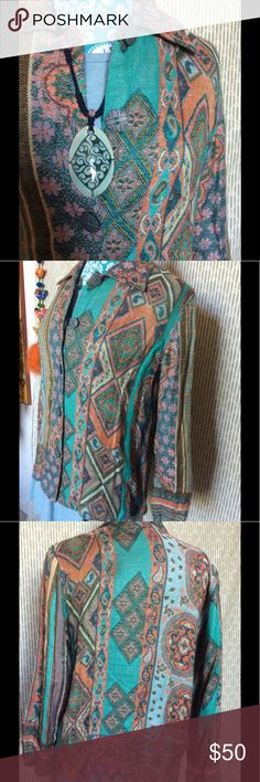 """SOFT Travel Smith Artsy Rainbow Cardigan Blazer Made in India. Smoke free home. Great to pack on vacation. Professional, classic yet funky. Multi rainbow colors in sky blue, teal, Aqua, orange, power blue. Architectural weave designs. Greek spirals. Flowers, diamonds. Paisley print.  Excellent condition. Bold carved buttons up the front. Long sleeve. Sweater Measurements laying flat: Bust 21"""" Length 25"""" Waist 21"""" Shoulder to Shoulder 16.5"""" (seems like normal girls size medium) jacket c…"""