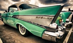 1957 Chevy Bel Air. I love the color and the dark clouds reflecting in the paint!