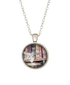 Take a look at this Silvertone Cat and Books Necklace today!