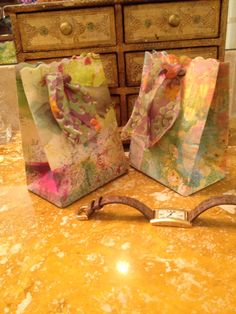 Small gift bags made from mop up papers by Claire.
