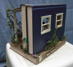 shed from books http://www.shannonsminis.com/avboxes.html The site has more book boxes