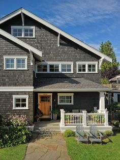 Charcoal shingles w/natural wood door and white trim