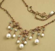 Copper, pearl and zircon. In my Etsy shop