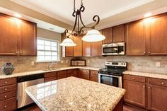 Kitchen   Aristokraft Cabinetry Sinclair Maple Saddle, Designed By Angela  Raines At Our Gallery Kitchen