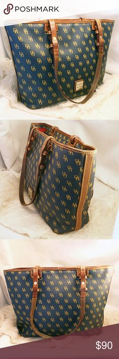 """Dooney & Bourke Blue / Teal Purse Handbag 15""""x10""""x7"""". Blue with yellow DB pattern & Brown strap Dooney & Bourke. There is wear on the handles, straps, and the inside of the bag is dirty. Overall, the outside is clean, but does show wear to straps / One string coming loose. Non smoking. I do have a dog, but it does not access my purses. The bottom corner has worn through slightly. See all pictures before buying. Dooney & Bourke Bags Shoulder Bags"""