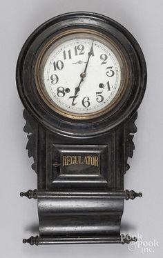 "Ebonized regulator wall clock, 19th c., 22"" h."
