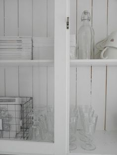 White walls, white dishes, white cabinets, glass & wire: perfection