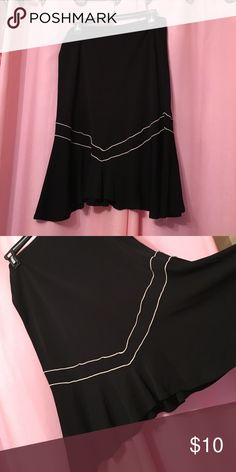 Black Knee Length Skirt Black skirt; I'm 5'4 and it goes right above my knees; If you have any questions, please let me know 😊 Max Studio Skirts A-Line or Full
