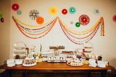 {  HANDMADE BRIGHT AND ECLECTIC TEXAS WEDDING  }  From the bride, Mindi: The main things that made our wedding so special was the fact the the whole thing was conceptualized and created while I worked full time, was in my last semester of graduate school, and was able to keep the whole thing under $20k. Jacob and I met in 3rd grade when he popped my training bra… little did we know, that exactly 20 years later he would be popping the most important question of his life!