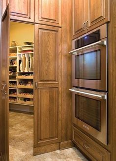 Hidden walk-in pantry.. different cabinets but love the idea!